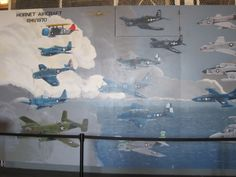 """""""USS Hornet Aircraft"""" by artist Rich Radigonda, a San Francisco native who served on the USS Ticonderoga. These squadrons pictured here were assigned to the Hornet and flew off the aircraft between 1942-1970."""