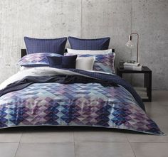 Create a unique style to your living space with Atari Blue Quilt Cover Set by Ltd. which features a contemporary geometric print design in triangular shaped patterns on the front and reverse printed in cool colour palette.