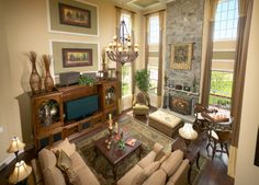 Toll Brothers Family room with cedar beam ceiling and cozy marble fireplace