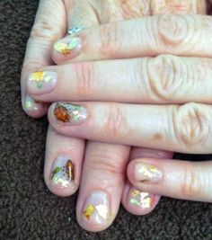 Tori recently added some shine to au naturel nails with bits of foil and leaf designs.