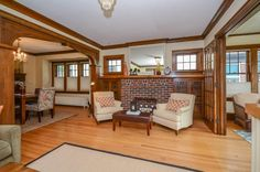 Delightful Craftsman 2 story impeccably maintained. Beautiful hardwood floors and woodwork. Wonderful south facing sun room. Beautiful built-in buffet. Absolutely lovely kitchen w/ original cabinetry. Stunning yard w/ pond, generous decking and brick patio!! Lovely!! Fireplace is decorative.