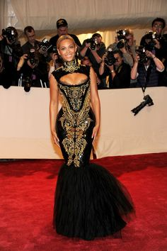 Beyonce tapped into her Sasha Fierce alter-ego in a high-fashion couture gown by Emilio Pucci at the 2011 Met Gala. The high-necked gold-embroidered gown was a study in contrast: high neck, peekaboo bust; the glint of gold against the black; voluminous skirt blooming from a slinky figure