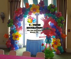 Trolls theme Birthday Party. Trolls balloon arch with flowers. Trolls balloon sculpture. Trolls birthday party ideas. Party decorations Miami. www.extremedecorations.com Extreme Decorations Miami Ph: 786-663-8198