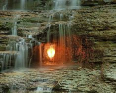Eternal flame waterfall - near Buffalo, New York.  pocket of natural methane gas in an alcove below the waterfall