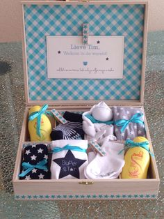 "baby boy welcome to the world gift basket in a storage box idea When we give baby shower gifts, we want the ""aaaaw."" A Hallmark Stylist shows baby gift wrap ideas using basic craft supplies, common gifts, and wrap. Baby Boy Gift Baskets, Baby Gift Wrapping, Baby Gift Box, Baby Shower Gift Basket, Baby Hamper, Baby Box, Baby Shower Gifts For Boys, Baby Boy Gifts, Wrapping Ideas"