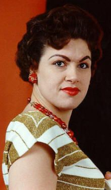 Patsy Cline.  Stunning voice.  She had alot of great styles in fashion - mostly C&W but this is a nifty fifties' look that I especially like.
