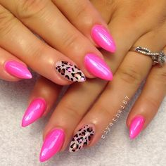Bright pink almond nails with cheetah accent nail