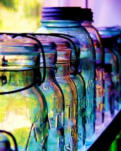 Mason jars - they are wonderful for so many things, from vases to cotton ball and q-tip holders to just stand alone like these in a line for us to admire.
