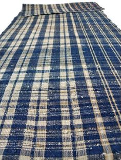 """Zanshi weaving (zanshi orimono) is a Japanese word which means """"vestige,"""" or """"leftover"""". Zanshi textiles were woven from the extra threads which remained after looming fixed pattern weavings."""