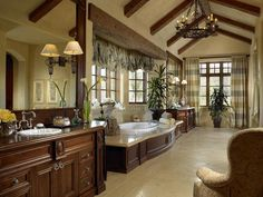 10 Luxury Bathrooms - If money were no object - notes: pretty with the floor color, stained cabinets and tans - calming effect.