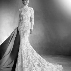 The full length view of Elivra by Atelier Pronovias, as seen on our romantic, high drama Gothic wedding inspiration board today. Elivria is a unique and striking mermaid skirt wedding dress with long sleeves and a high neck, covered in a delightful combination of guipure, tulle and lace.⠀ ⠀ See more on our blog - link in profile.⠀ ⠀ #weddinginspiration #weddingideas #weddingmoodboard #inspirationboard #wedding #weddings #bride #bridal #bridalstyle #missbush #missbushsurrey #fashion…