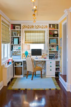 Metallic floral wallpaper and light blue FLOR tiles create a pleasant place to get things done in this custom built-in home office.
