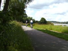 Brabrandstien ved Aarhus. The cycle path at Brabrandsstien near Aarhus, with the river running through the center of Aarhus and out in Aarhus harbor.