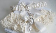Alencon Beaded Lace Garter Set in Ivory with Pearls and Rhinestone Teardrop Cabochons and Bow Centerings. $45.00, via Etsy.