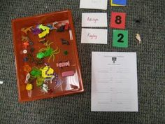 Children draw names, numbers, and objects to create math word problems.