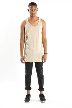 Loose Tank by Knomadik – at Machus. A loose fitted, elongated tank with exaggerated side slits.