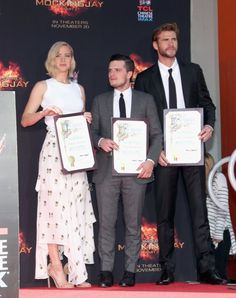 Pin for Later: Jennifer Lawrence, Liam Hemsworth, and Josh Hutcherson Leave Their Stamp on Hollywood