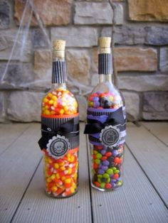Great alternative hostess gift repurpose wine bottles with candy pieces ~ fill by season, i.e. spring/jelly beans, summer/M, autumn/candy corn, winter/York peppermint pieces . . . many possibilities.