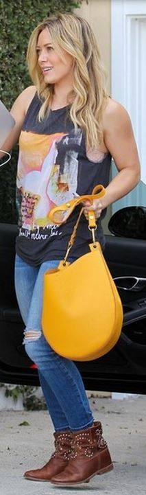 Who made  Hillary Duff's yellow hobo bag and brown studded ankle boots?
