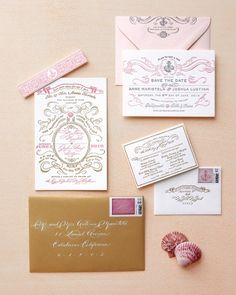 Seashell Stationery  To fit the theme of beach wedding invitations were made in a seashell palette with filigree flourishes.