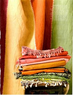 indian textiles (texture, plus the pile of folded textiles makes me want to touch and go through the pile!)