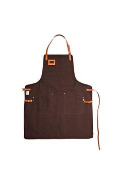 Apron in heavy, 18oz cotton canvas, designed in collaboration with the swedish star chef Niklas Ekstedt. Straps and details in thick, cognac brown leather.