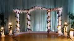 The main backdrop is bordered by lamps atop Grecian pillars that add a warm light to the scene I like this for the ceremony. would br really pretty Greek Garden, Grecian Wedding, Prom Decor, Prom 2014, Wedding Pictures, Decor Styles, Scene, Baby Shower, Wedding Backdrops