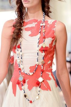 embellished detailed fashions flower dress and beaded shell necklace