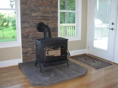 wood stove ideas | Stone surround | Wood Burning Stove Installation Ideas