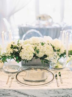 Centerpiece of white flowers with greenery in low silver vase, a silver rimmed glass charger plate, clear lucite chairs - White and Green Wedding - by Flora Nova Design Wedding Reception Flowers, Wedding Reception Centerpieces, White Wedding Flowers, Cream Flowers, Green Wedding, White Flowers, Floral Wedding, Low Centerpieces, Country Club Wedding
