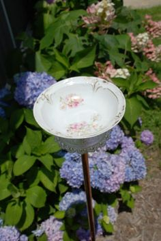 Make a little bird bath out of old china and glass