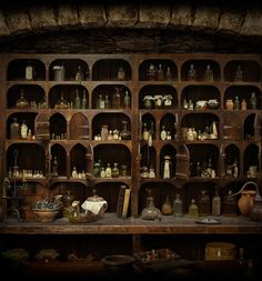 Old apothecary shop crammed with jars and bottles of herbs and liquids.