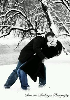 Engagement photo in the snow.