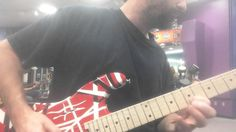 Chad Garber messing around with an EVH guitar at Guitar Center