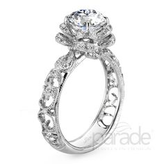 Style Number: R2902/R1   This Vintage-Floral inspired design is anything but your typical engagement ring as milgrain etched scrolls curl and climb towards a round-cut diamond emerging from a blossoming flower