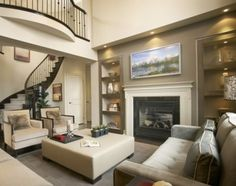 Two story living room - love the staircase.