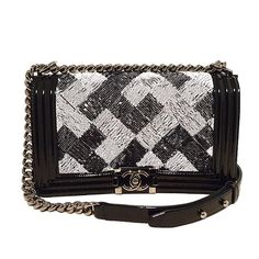 Chanel Sequin Black Patent Leather Classic Flap Boy Bag | From a collection of rare vintage shoulder bags at https://www.1stdibs.com/fashion/handbags-purses-bags/shoulder-bags/