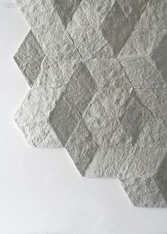 Exciton/Hive tiles in recycled marble dust by Realstone Systems.
