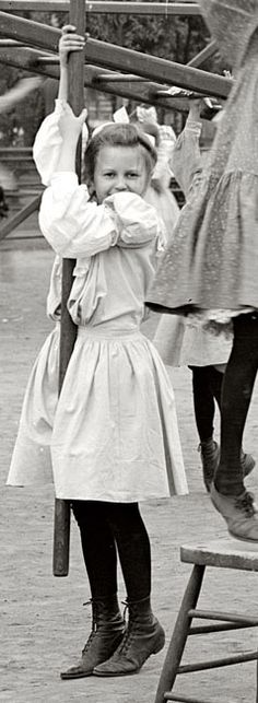 U.S. Girl hanging on a pole, c. 1905 Harriet Island, St. Paul, Minnessota