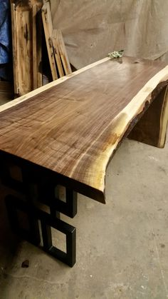 This amazing black walnut desk is 24-27 wide, 2 thick, and stands at 30 tall. The grain tones are amazing with each piece and each desk consists of a