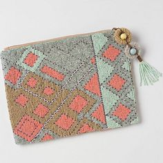 NWT Anthropologie Jasper and Jeera beaded clutch! NWT Jasper and Jeera for Anthropologie beautiful beaded clutch! No flaws, never used. This style is SOLD OUT! New with tag. BUNDLE and SAVE! Anthropologie Bags Clutches & Wristlets