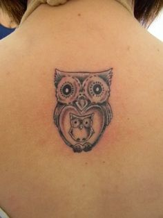 I thought maybe I wouldn't get another tattoo, but I might wait till our family is complete and do a mama owl with her babies.  Love this one!
