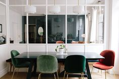 Morgane Sezalory's Paris Apartment | Glass wall to separate the kitchen is genius... keeps out kitchen smells!