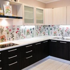 Fun spin on kitchen backsplash, floral all the way. Two toned cabinets nice too. White and black and color all between. Quite whimsical mixed with straight up contemporary cabinetry and hardware