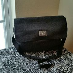 LUCKY BRAND...GORGEOUS MESSENGER BAG..... ...EXCELLENT CONDITION  ...LIKE NEW  ...NO FLAWS  ...GORGEOUS  ...true to its size  ...color.... gray... ...long shoulder strap ...zipper pocket inside  ...plenty of room  ...for books ,lap top  ....3 pic....shows great condition  ....MTRL....WOOL FEEL.... ...LOGO ...on front ....better in person Lucky Brand Bags