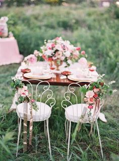 Find preserved rose heads at Afloral.com to DIY these chair swags, as seen on http://www.stylemepretty.com/2014/08/27/bohemian-inspired-field-wedding/