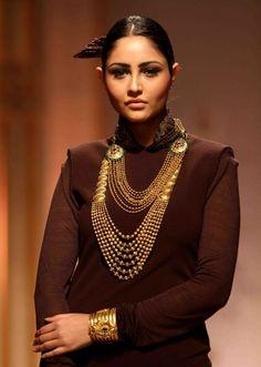 Purva Rana showcases gold jewellery creations by Azva during India Bridal Fashion Week '13, held at Grand Hyatt, in Mumbai.