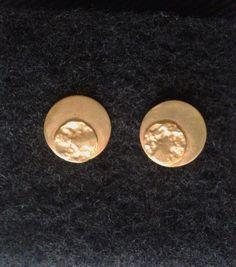 Aretes sol tex en plata con baño en oro 30.000 pesos