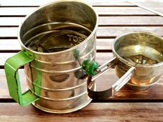 Vintage Flour Sifter, Set of 2, One Large, One Small With an apple green handle and crank, the large sifter says Retro! its graphics say