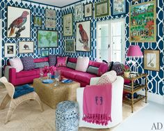 Miles Redd: The existing grass-cloth wall covering in the television room was stenciled over by Pearson and hung with art, including parrot illustrations from Natural Curiosities; the Dune sectional is clad in an Osborne & Little fabric.